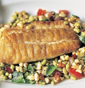 """** FOR USE WITH AP WEEKLY FEATURES ** This photo provided by Artisan shows Flounder With Lady Pea Succotash, made with a recipe from """"Frank Stitt's Southern Table: Recipes and Gracious Traditions From Highlands Bar and Grill."""" The flounder is complemented by the tender lady peas, Stitt points out, and the addition of basil, dill and chives makes a very simple dish very special. (AP Photo/Artisan/Christopher Hirsheimer)"""