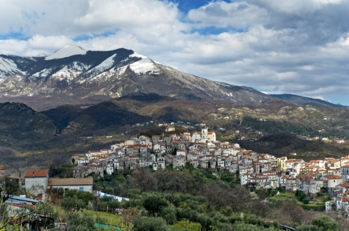 Italian village with mountains in the background