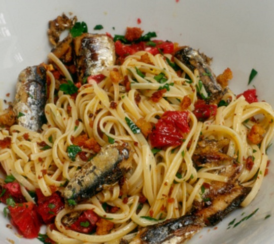 Linguine with sunblush tomatoes, parsley, sardines and fried bread crumbs