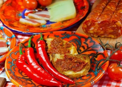 The south Italy, Calabria, locale food - soft sausage nduja, peper, tomato, cheese